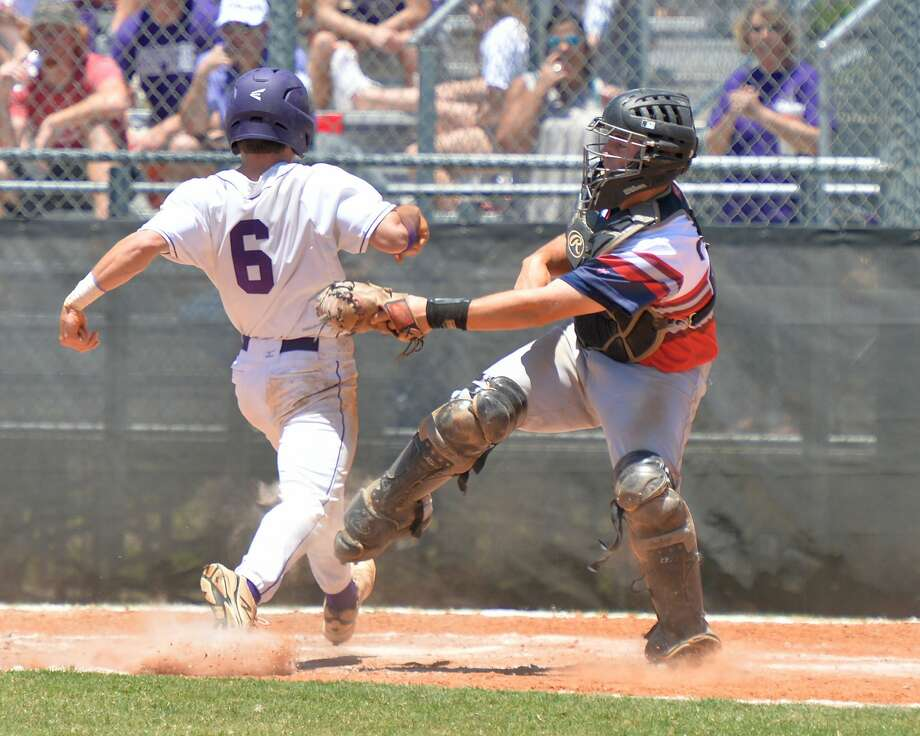 Ian Fink (6) of Ridge Point beats the tag by Sam Frank (28) of Lamar and scores in the fourth inning of game 3 in a 6A-III area round baseball playoff series between the Lamar Texans and the Ridge Point Panthers on Saturday May 13, 2017 at Jersey Village HS, Jersey Village, TX. Photo: Craig Moseley/Houston Chronicle