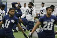 Defensive tackle Malik McDowell (94), the Seattle Seahawks' top draft pick, stretches during NFL football rookie minicamp, Friday, May 12, 2017, in Seattle. (AP Photo/Ted S. Warren)