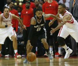 Spurs' Patty Mills (8) steals the ball from the Rockets' Eric Gordon (right) in the 103-92 victory.