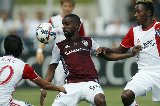 Colorado Rapids midfielder Mohammed Saeid, center, looks to control the ball as San Jose Earthquakes midfielder Jahmir Hyka, left, and forward Cordell Cato defend during the first half of an MLS soccer match Saturday, May 13, 2017, in Commerce City, Colo. (AP Photo/David Zalubowski)