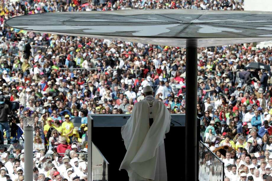 Pope Francis delivers his homily during a mass at the Sanctuary of Our Lady of Fatima Saturday, May 13, 2017, in Fatima, Portugal. The pontiff canonized on Saturday two poor, illiterate shepherd children whose visions of the Virgin Mary 100 years ago marked one of the most important events of the 20th-century Catholic Church. (AP Photo/Alessandra Tarantino) Photo: Alessandra Tarantino, STF / Copyright 2017 The Associated Press. All rights reserved.