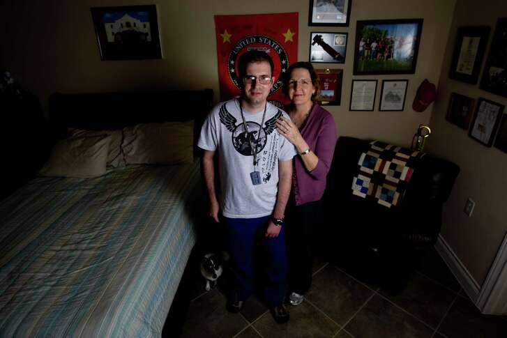 In this 2011 photo,  retired Marine Cpl. Steven Schulz stands next to his mother, Debbie, in their Friendswood home.