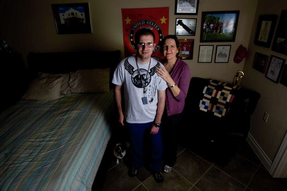 In this 2011 photo,  retired Marine Cpl. Steven Schulz stands next to his mother, Debbie, in their Friendswood home. Photo: Billy Smith II, HC Staff / Houston Chronicle