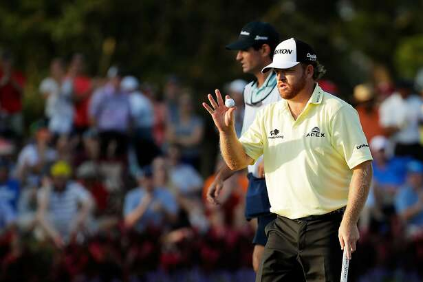 PONTE VEDRA BEACH, FL - MAY 13:  J.B. Holmes of the United States reacts after putting for birdie on the 17th green during the third round of THE PLAYERS Championship at the Stadium course at TPC Sawgrass on May 13, 2017 in Ponte Vedra Beach, Florida.  (Photo by Andy Lyons/Getty Images)