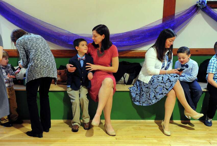 Bridget Sielicki and her son Dominic, 8, attend Assumption School's 1st Annual Ladies and Little Gents Dance held in the school's newly renovated gym in Ansonia, Conn., on Saturday May 13, 2017. In celebration of Mother's Day, moms as well as grandmas, aunts or other mother figures and sons (up to 8th Grade) came to enjoy the dance. The night included light refreshments and pizza as well as snacks and dessert. A DJ provided music and a souvenir photo station was set up to pose moms with their sons.