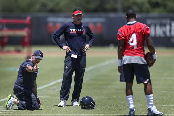 Texans Coach Bill O'Brien gives DeShaun Watson feedback as he runs through drills during Texans rookie camp at NRG practice field   Saturday, May 13, 2017, in Houston. ( Steve Gonzales  / Houston Chronicle )