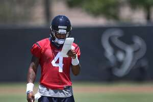 DeShaun Watson, quarterback from Clemson goes over the plays before runing through drills during Texans rookie camp at NRG practice field   Saturday, May 13, 2017, in Houston. ( Steve Gonzales  / Houston Chronicle )