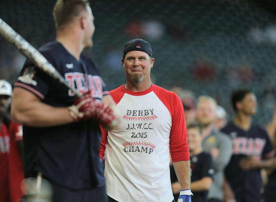 Houston Texans punter Shane Lechler (9) taunts J.J. Watt (99) with a home made t-shirt he made after the 2015 home run derby during Watt's 5th annual celebrity charity baseball game at Minute Maid Field on Saturday, May 13, 2017, in Houston. ( Elizabeth Conley / Houston Chronicle ) Photo: Elizabeth Conley/Houston Chronicle