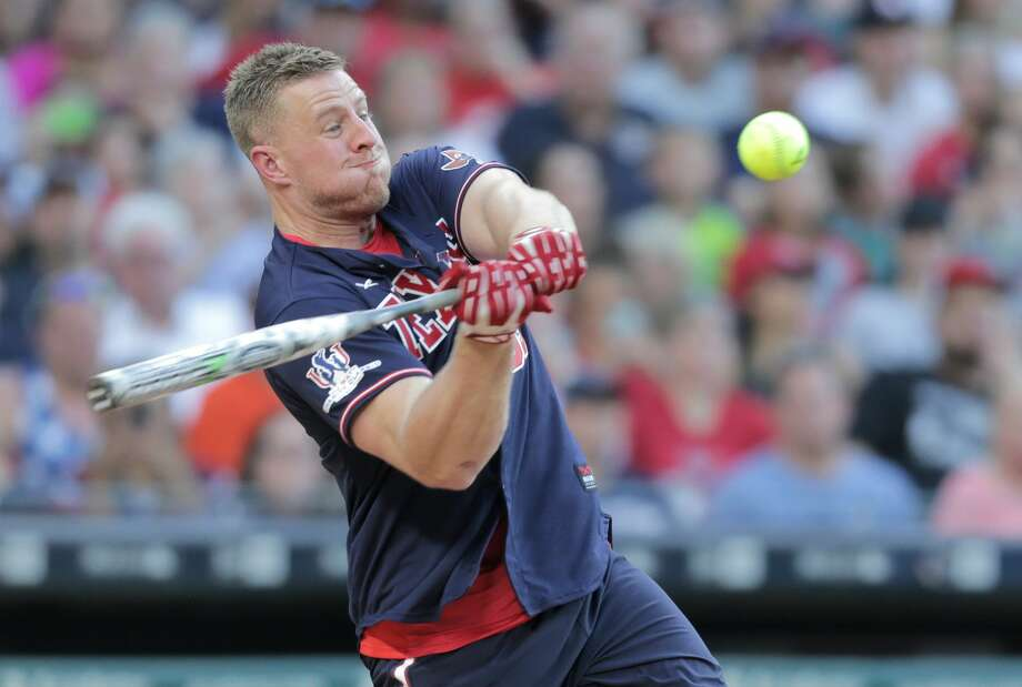 Houston Texans defensive end J.J. Watt (99) connects for a single during his  celebrity charity baseball game at Minute Maid Field on Saturday, May 13, 2017, in Houston. ( Elizabeth Conley / Houston Chronicle ) Photo: Elizabeth Conley/Houston Chronicle