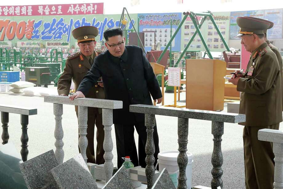 North Korean leader Kim Jong-Un, right, has said it is his goal for his country to develop an intercontinental ballistic missile capable of reaching the U.S. Photo: STR, Stringer / AFP or licensors