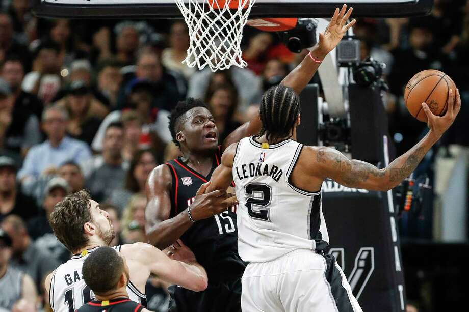 Though Clint Capela and the Rockets could not stop Kawhi Leonard, right, and the Spurs in the playoffs, Capela enjoyed a big series, averaging 13 points, 10.5 rebounds and 2.5 blocked shots. Photo: Karen Warren, Staff Photographer / 2017 Houston Chronicle