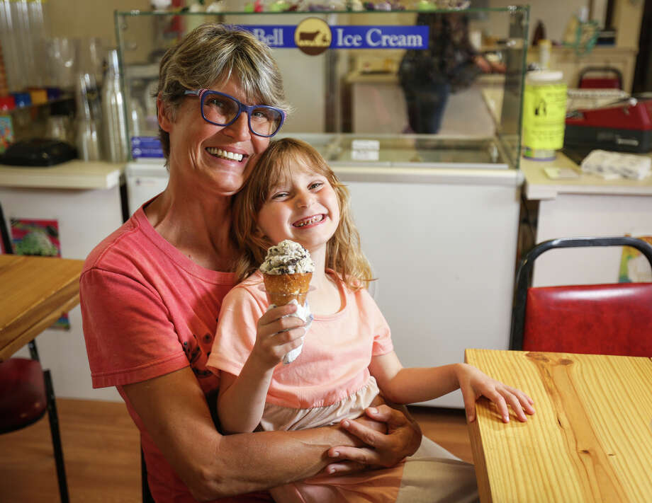 Owner Jacki Burke and her daughter Dorothy, 5, holding a pretzel cone with cookies and cream ice cream, pose for a portrait on Tuesday, May 9, 2017, at Jacki's Ice Cream Hutt. Photo: Michael Minasi, Staff Photographer / © 2017 Houston Chronicle