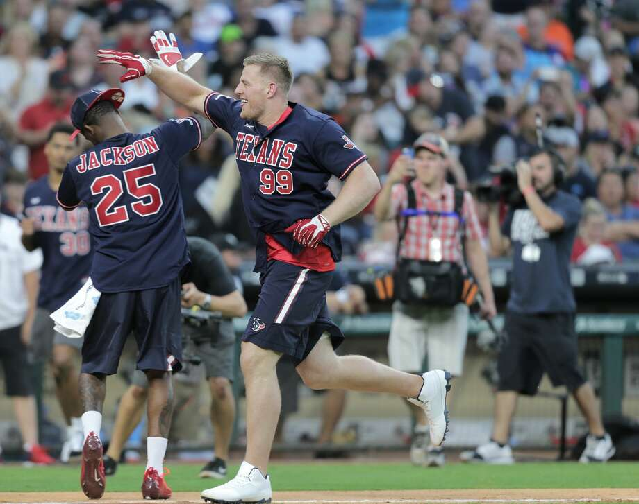 Houston Texans defensive end J.J. Watt (99) celebrates his home run as he makes his way around the bases past  cornerback Kareem Jackson (25) during Watt's annual celebrity charity baseball game at Minute Maid Field on Saturday, May 13, 2017, in Houston. ( Elizabeth Conley / Houston Chronicle ) Photo: Elizabeth Conley/Houston Chronicle