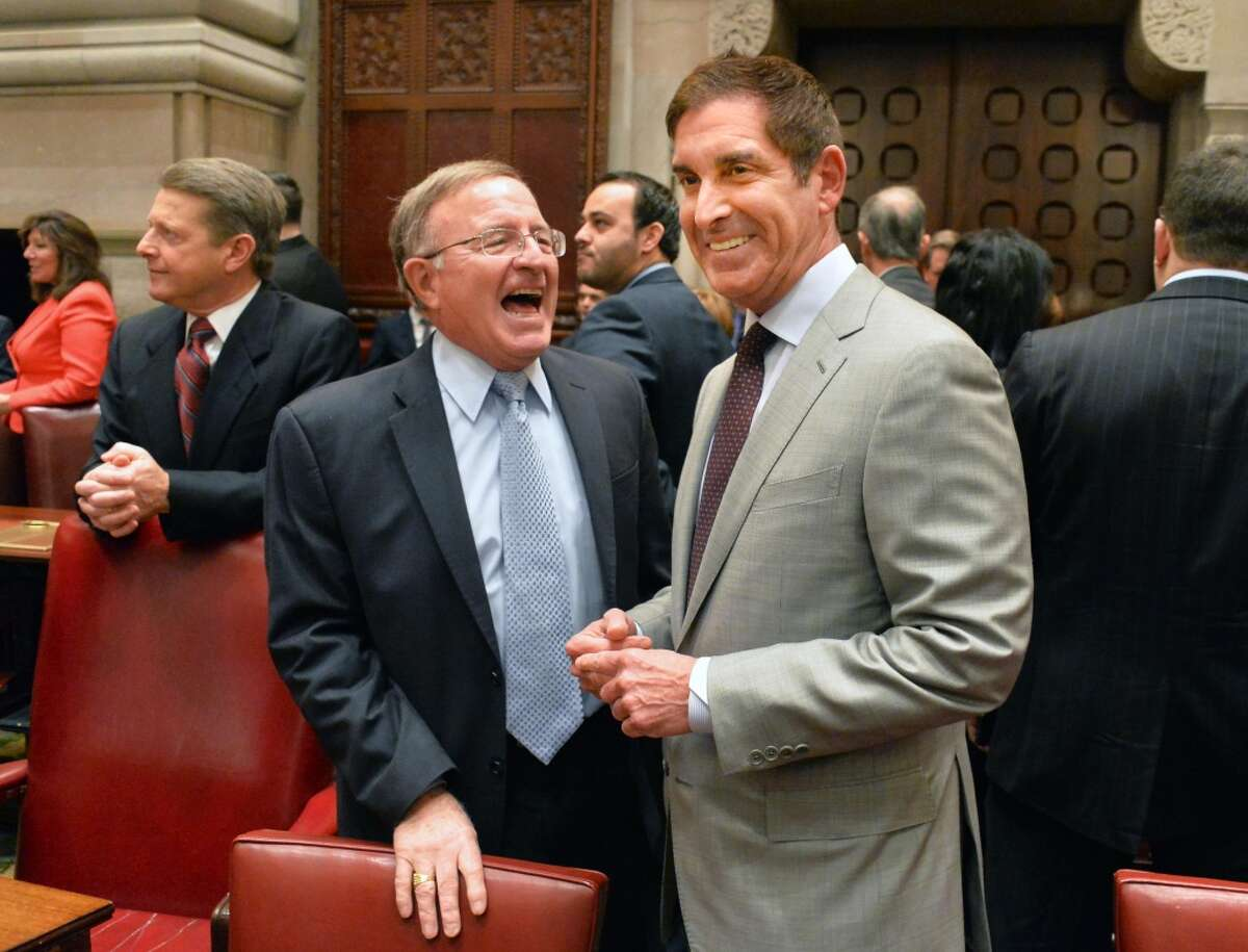 GOP Sen. John DeFrancisco laughs with and not at IDC leader Sen. Jeffrey Klein before the start of the Senate's first session of 2015. (John Carl D'Annibale, Times Union)