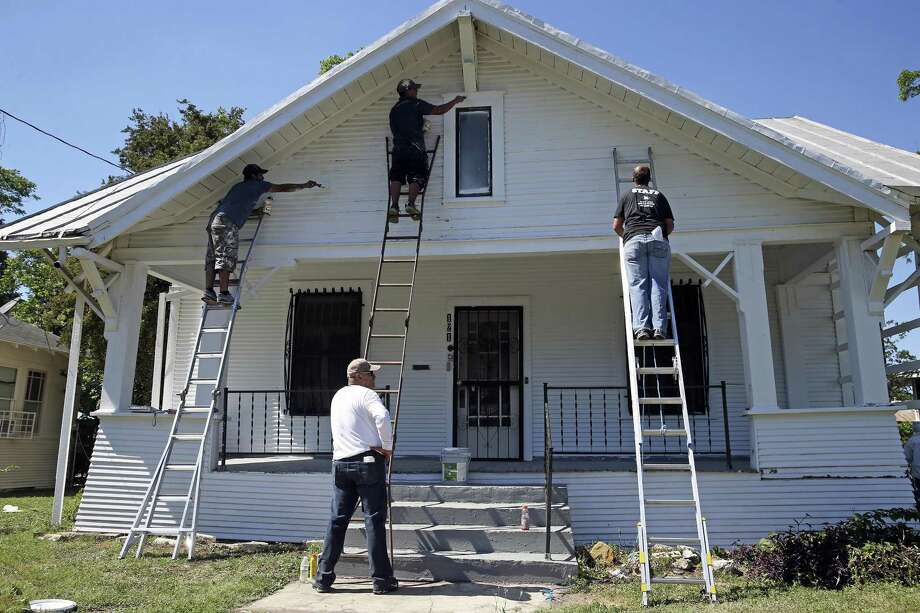A crew takes on the front paint job of a home during Rehabarama, a project to revitalize homes on two blocks of Harding place on May 13, 2017.  These workers a with the Office of Historic Preservation.  From left are Josh Barkley, Gilbert Ramirez, Christian Morales and John Stevens. Photo: Tom Reel, Staff / San Antonio Express-News / 2017 SAN ANTONIO EXPRESS-NEWS