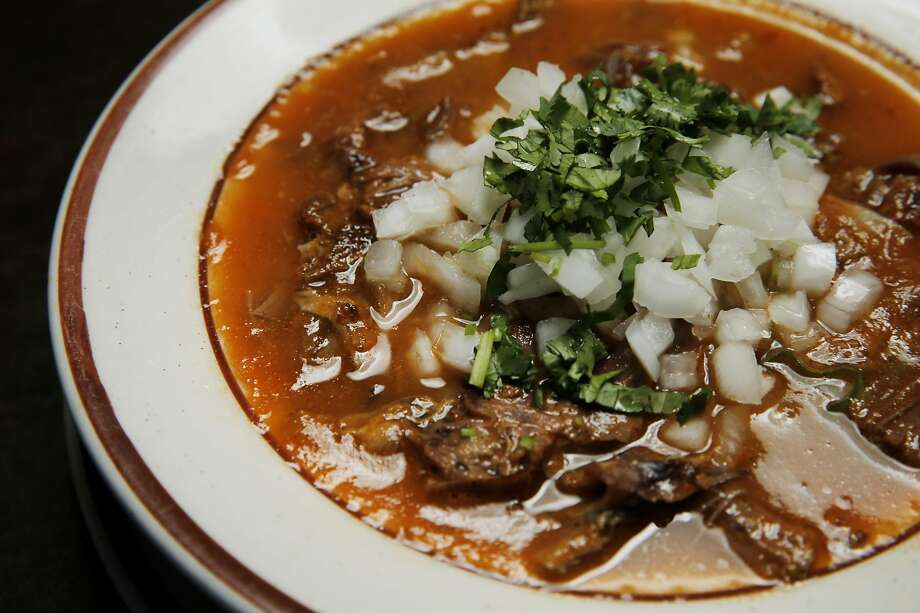 At El Potrillo, a bowl of birria sprinkled with onions and cilantro. Photo: Santiago Mejia, The Chronicle