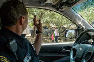 Officer Jose Flores of the Tucson Police Department patrols a neighborhood densely populated by Latinos. The law requiring officers to inquire about immigration status greatly complicates their job, some police say.