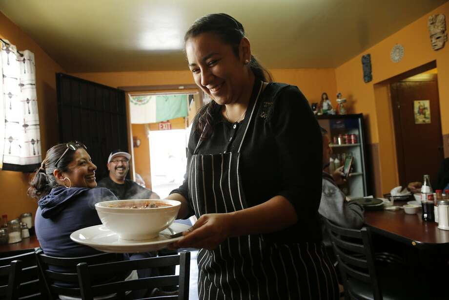At La Casita in Oakland, Raquel Martinez serves a bowl of birria. Photo: Santiago Mejia, The Chronicle