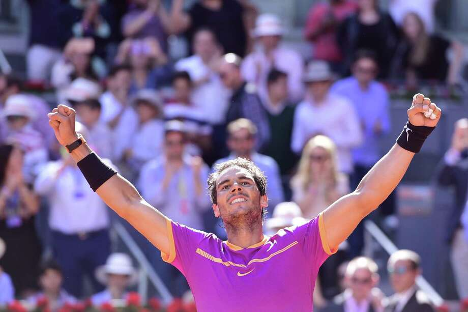 Spain's Rafael Nadal celebrates his victory over Serbia's Novak Djokovic during their ATP Madrid Open semifinal match Saturday. Nadal won 6-2, 6-4 to advance. Photo: JAVIER SORIANO, Staff / AFP or licensors