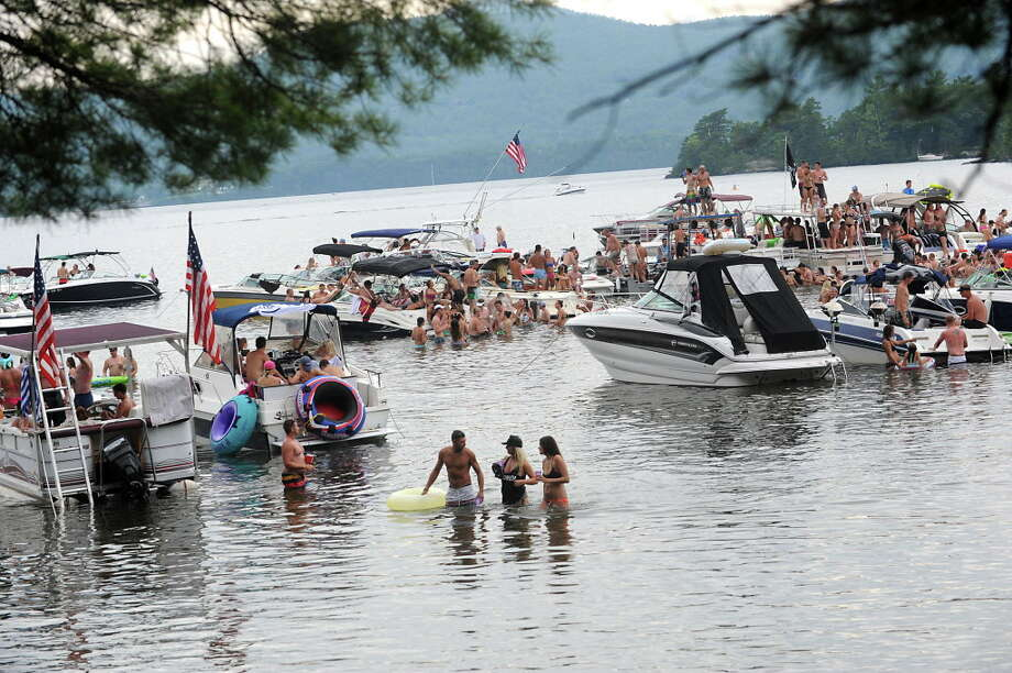People enjoy the water during Log Bay Day, the annual party on the water on the east side of Lake George at Log Bay on Monday July 25, 2016 in Bolton, N.Y. (Lori Van Buren / Times Union) Photo: Lori Van Buren / 20037423A