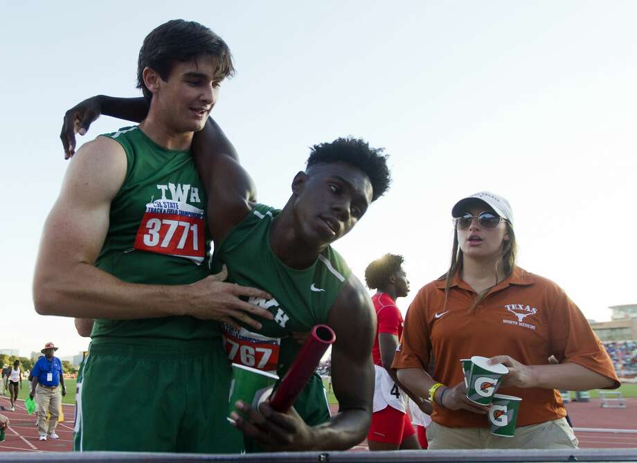 The Woodlands' Jake Lanier, left, helps Kesean Carter up as he celebrates winning the 6A boys 4x200 meter relay during the UIL State Track & Field Championships, Saturday, May 13, 2017, in Austin. Photo: Jason Fochtman/Houston Chronicle