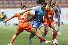 Houston Dash players Amber Brooks (12) and Janine Beckie (16) defensing Sky Blue FC midfielder Raquel Rodriguez (11) during the first half of the game at BBVA Compass Stadium Saturday, May 13, 2017, in Houston. ( Yi-Chin Lee / Houston Chronicle )