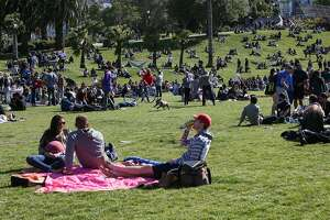 A large crowd is seen enjoying the sunny day in Dolores Park on Saturday, May 13, 2017 in San Francisco, Calif.