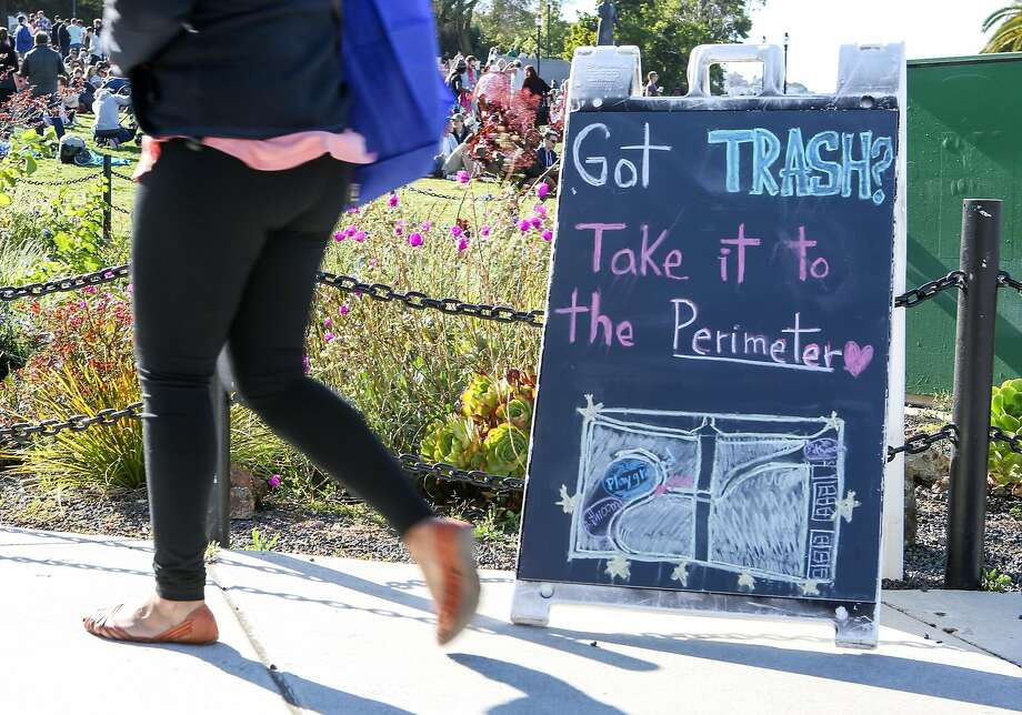A sign instructing people to bring their trash to the perimeter of the park is seen in Dolores Park on Saturday, May 13, 2017 in San Francisco, Calif. Photo: Amy Osborne, Special To The Chronicle