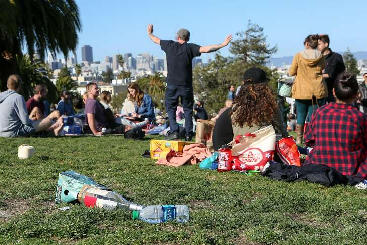A pile of garbage left by park go-ers is seen in Dolores Park on Saturday, May 13, 2017 in San Francisco, Calif.