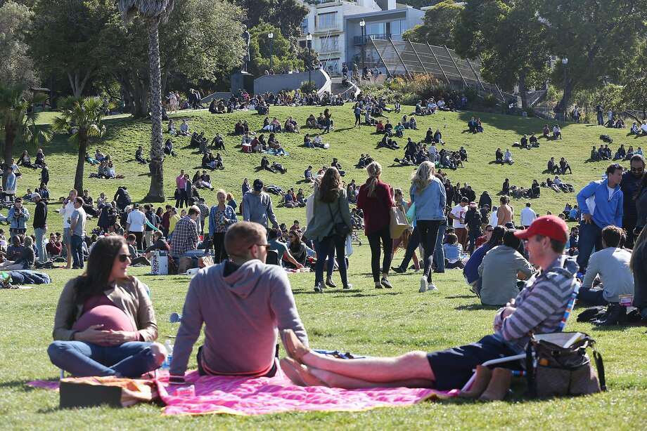A large crowd is seen enjoying the sunny day in Dolores Park on Saturday, May 13, 2017 in San Francisco, Calif. Photo: Amy Osborne, Special To The Chronicle