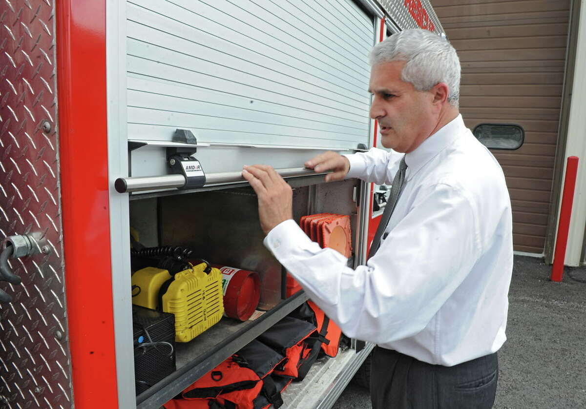 Then Fulton County Judge Richard Giardino closes the door on a rescue truck at the Mayfield firehouse where he is a volunteer firefighter on Friday, June 14, 2013 in Mayfield, N.Y. Giardino credited his communications staff, deputies and State Police for saving a distraught man who ran at police with a butcher knife on March 16, 2021. (Lori Van Buren / Times Union)