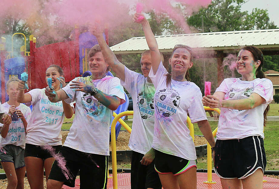 There was a lot of laughter and color all over the participants following their completion of the Color Run in Dayton last Saturday morning. Photo: David Taylor