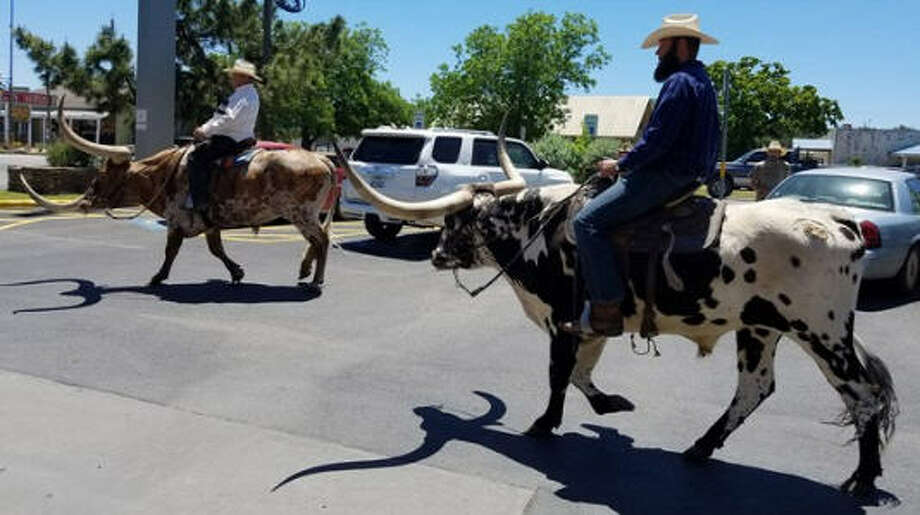 A bank in tiny Bandera, Texas, offers a ride-up ATM service. Wells Fargo in the town of 827 people, has customers who ride into the bank on Longhorns, horses and other animals.