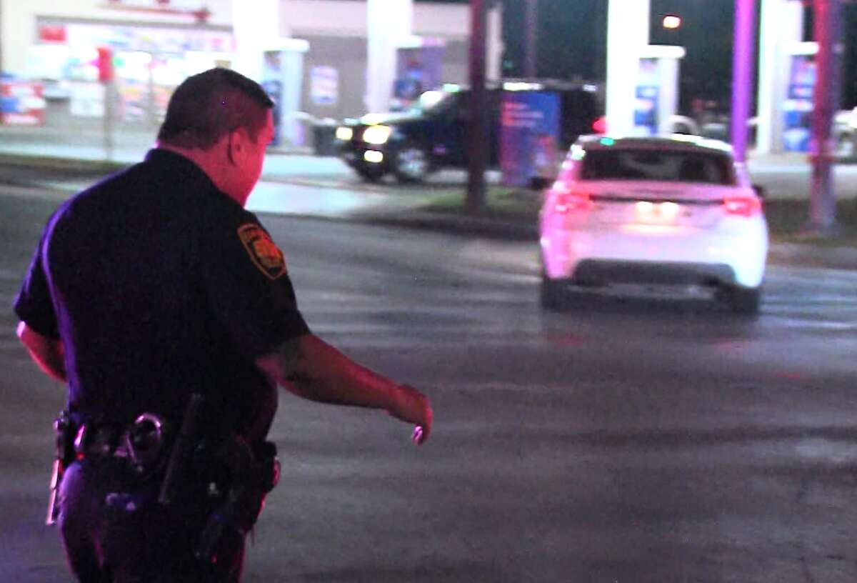 San Antonio police say an officer was dragged by a vehicle fleeing the scene of a suspected burglary on the far Northwest Side Saturday night, May 14, 2017.