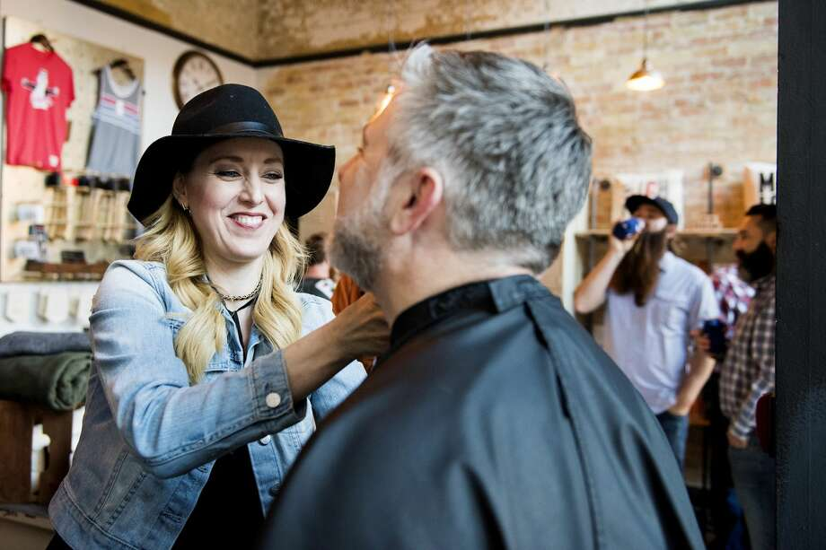 "Heather Spencer of A Spencer Gillise Salon styles Alan LaFave's beard during the second Battle of the Beards Thursday at Albert's General Store in Bay City. Spencer said her salon added facial hair care services a few years ago. ""Beards are really a trend right now,"" she said. Photo: Danielle McGrew Tenbusch"
