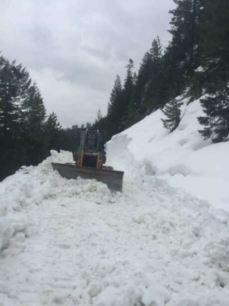 A Caltrans bulldozer tries to make headway last week to clear Highway 108 in a treacherous 15-mile section that rises 3,500 feet Photo: Tom Stienstra, Caltrans
