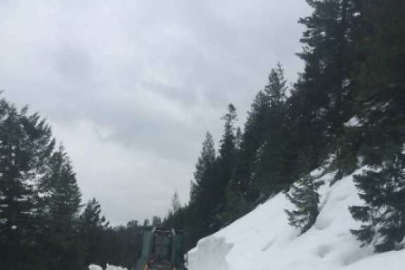 A Caltrans bulldozer tries to make headway last week to clear Highway 108 in a treacherous 15-mile section that rises 3,500 feet