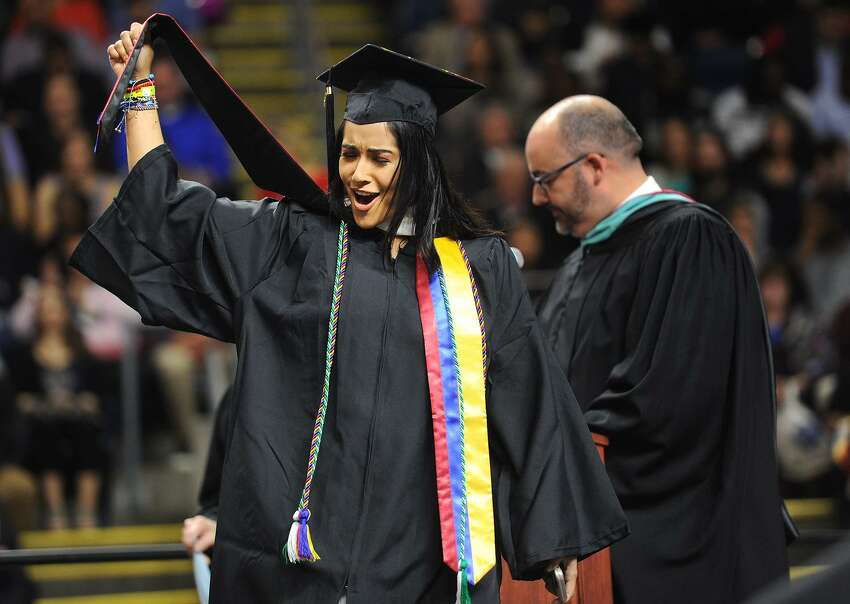 Graduate Juliette Rivera celebrates as she walks across the stage to receive her diploma during Sacred Heart University's 2017 Commencement ceremony at the Webster Bank Arena in Bridgeport on Sunday.