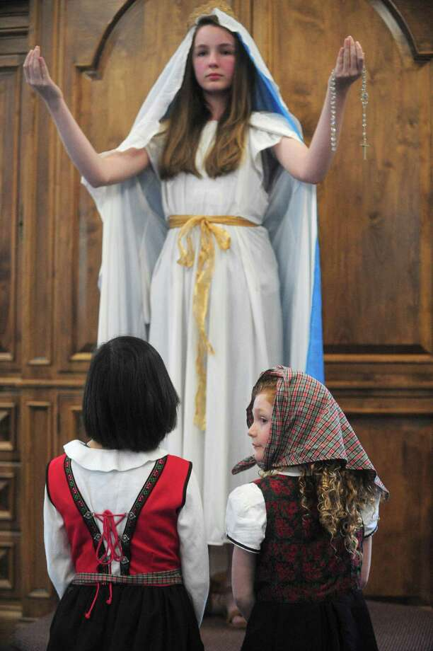 Alexandra Fordsman, 12, Sophia Lugo, 10, and Elizabeth McGuinness, 5, perform in the children's presentation on the six apparitions as Our Lady of Fatima Parish celebrates its 100th anniversary on Saturday, May 13, at the parish in Wilton, Conn. Photo: Erik Trautmann / Hearst Connecticut Media / Norwalk Hour