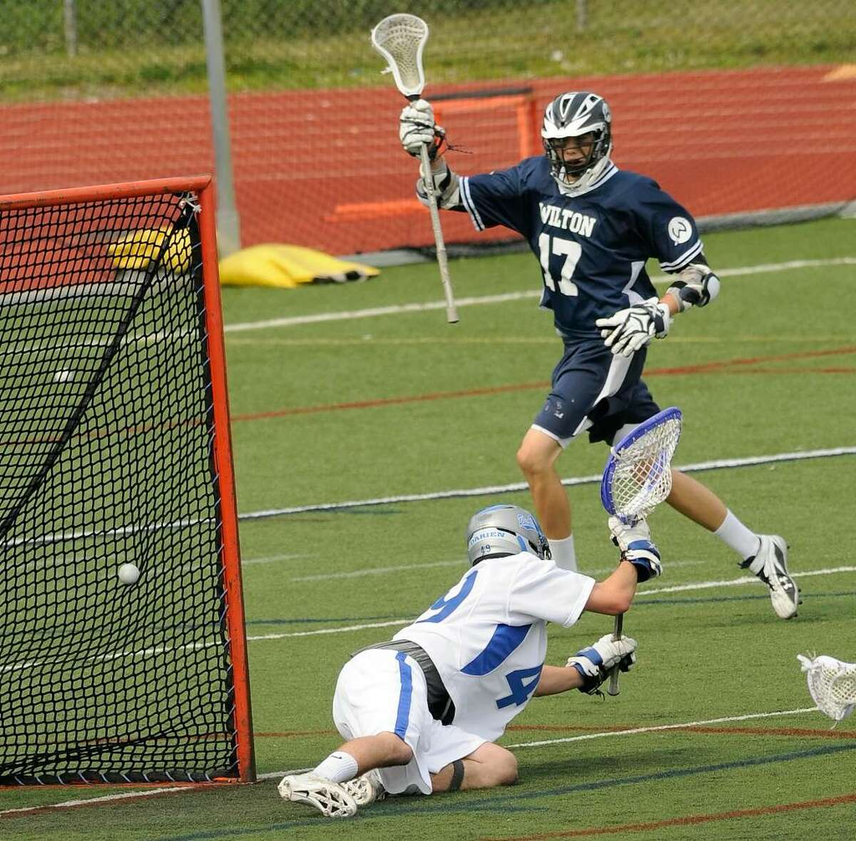Darien High School hosts Wilton High School for the boys' lacrosse quarterfinals on Saturday June 5, 2010. Wilton #17 Christopher Nugent celebrates Wilton's second goal of the game, as it gets past Darien goalie #49 Andrew West.