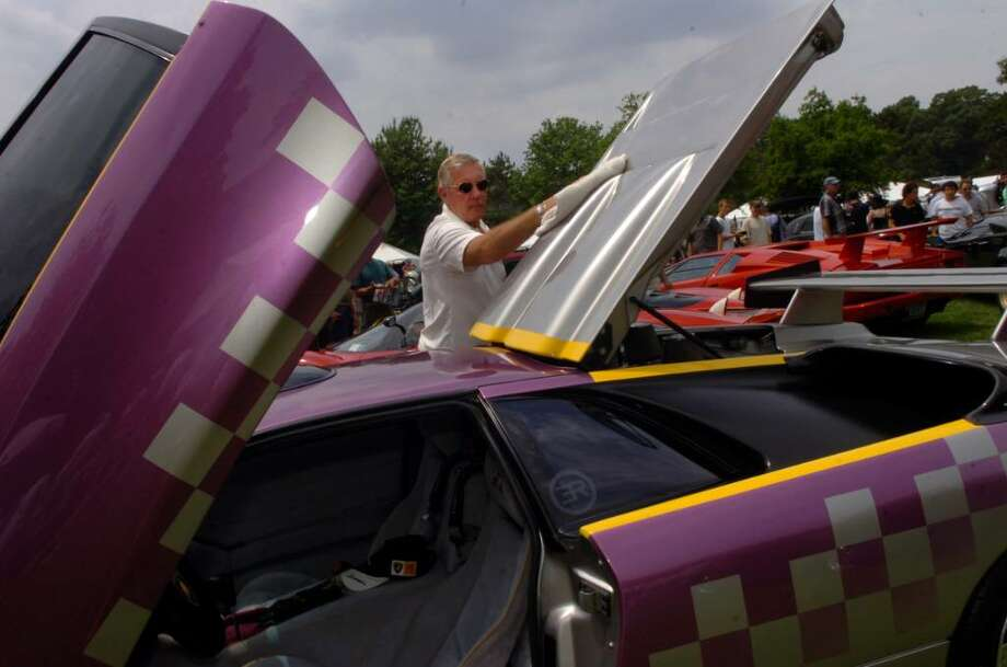Greg Blacerak, of Rockville Center, New York, dusts off his 1991 Lamborghini Diablo Jota Americana which he races as well as drives, at the 15th annual Greenwich Concours d'Elegance at Roger Sherman Park on Sunday, June 6, 2010. Photo: Helen Neafsey / Greenwich Time