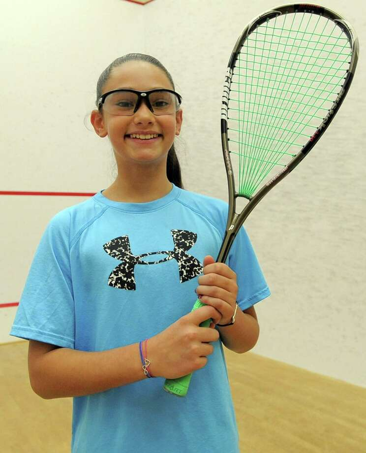 Eva Salzman, 10, is the #1  U.S. National Junior Squash Champoin for girls under 11 years old. She trains at Sportsplex in Stamford with Kumail Mehmood on May 10, 2017. Photo: Matthew Brown / Hearst Connecticut Media / Stamford Advocate