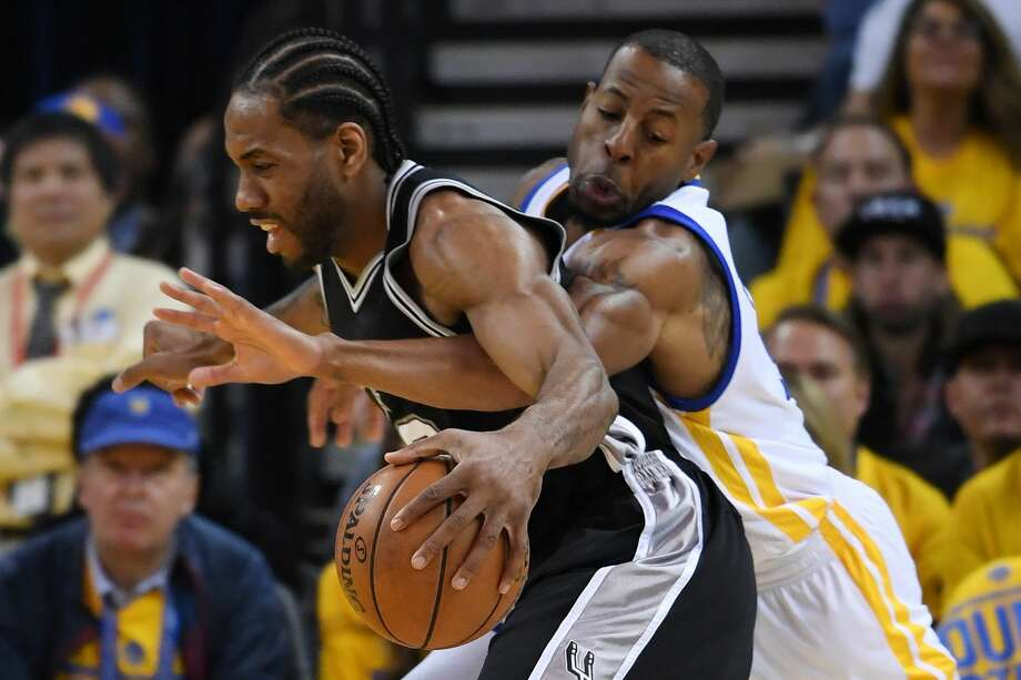 OAKLAND, CA - MAY 14:  Andre Iguodala #9 of the Golden State Warriors defends against Kawhi Leonard #2 of the San Antonio Spurs during Game One of the NBA Western Conference Finals at ORACLE Arena on May 14, 2017 in Oakland, California. NOTE TO USER: User expressly acknowledges and agrees that, by downloading and or using this photograph, User is consenting to the terms and conditions of the Getty Images License Agreement.  (Photo by Thearon W. Henderson/Getty Images) Photo: Thearon W. Henderson/Getty Images