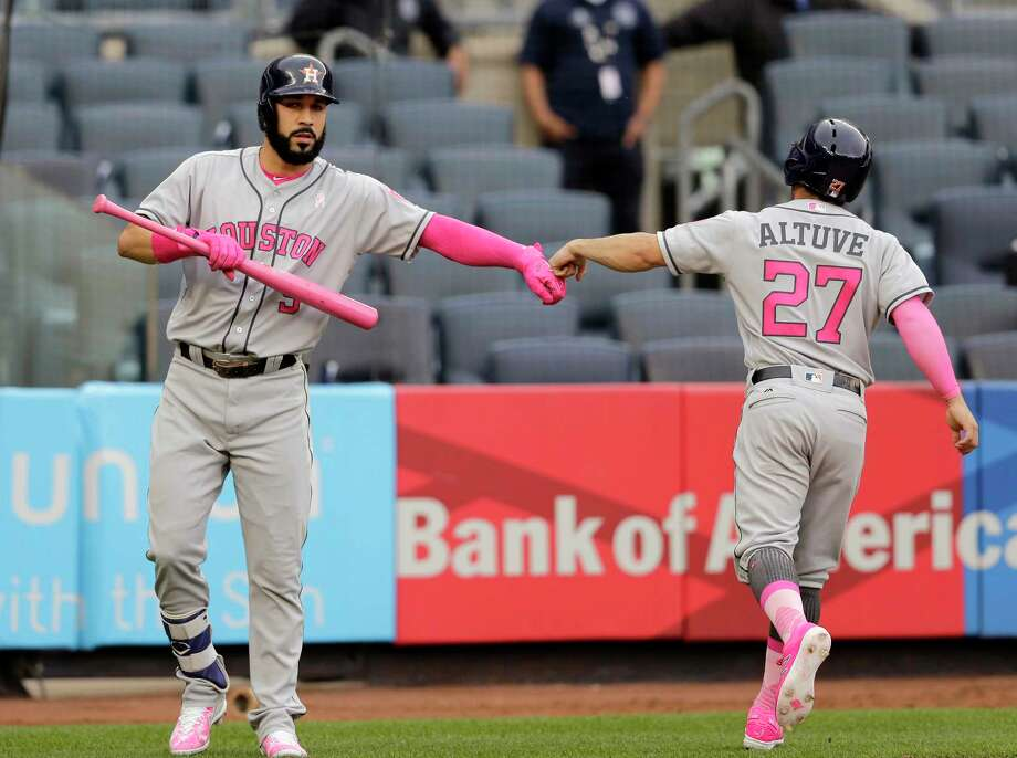 Jose Altuve's special pink cleats for Mother's Day were the reason behind his removal from Sunday's doubleheader nightcap in New York. Photo: Seth Wenig, Associated Press / Copyright 2017 The Associated Press. All rights reserved.