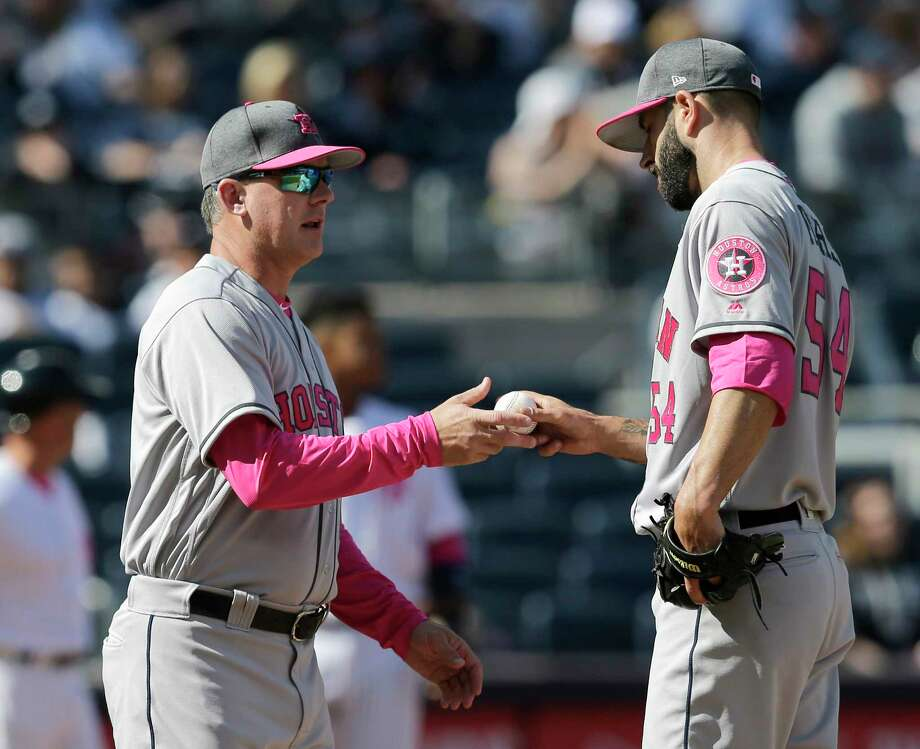 Houston Astros manager A.J. Hinch, left, takes starting pitcher Mike Fiers out of the game during the sixth inning of a baseball game against the New York Yankees at Yankee Stadium, Sunday, May 14, 2017, in New York. (AP Photo/Seth Wenig) Photo: Seth Wenig, Associated Press / AP