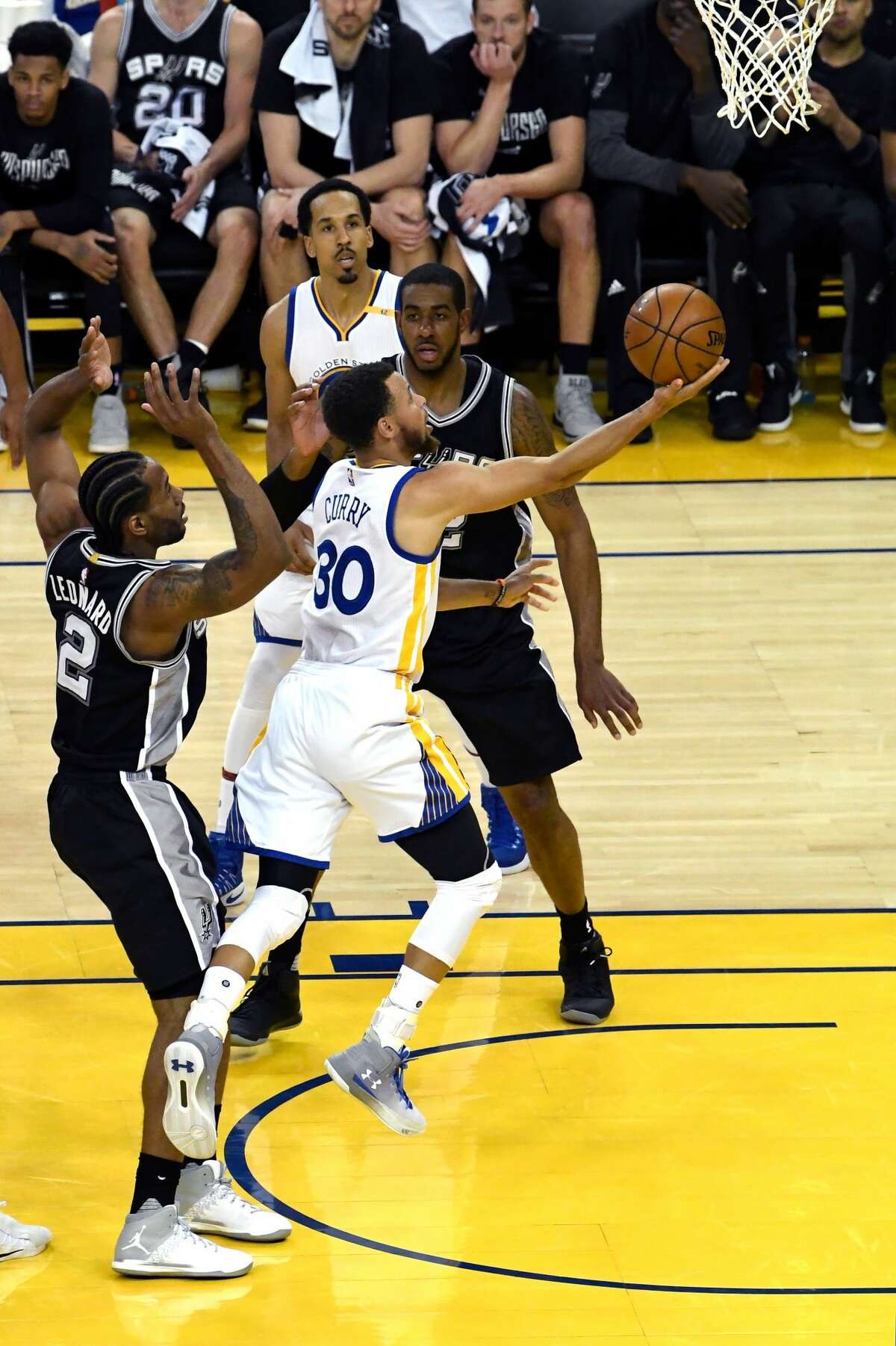 OAKLAND, CA - MAY 14: Stephen Curry #30 of the Golden State Warriors attempts a shot against the San Antonio Spurs during Game One of the NBA Western Conference Finals at ORACLE Arena on May 14, 2017 in Oakland, California. NOTE TO USER: User expressly acknowledges and agrees that, by downloading and or using this photograph, User is consenting to the terms and conditions of the Getty Images License Agreement. (Photo by Thearon W. Henderson/Getty Images)