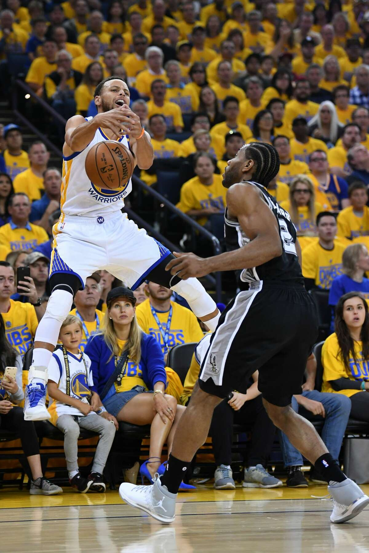 OAKLAND, CA - MAY 14: Stephen Curry #30 of the Golden State Warriors loses control of the ball during Game One of the NBA Western Conference Finals against the San Antonio Spurs at ORACLE Arena on May 14, 2017 in Oakland, California. NOTE TO USER: User expressly acknowledges and agrees that, by downloading and or using this photograph, User is consenting to the terms and conditions of the Getty Images License Agreement. (Photo by Thearon W. Henderson/Getty Images)