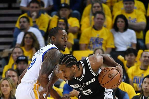 OAKLAND, CA - MAY 14:  Kawhi Leonard #2 of the San Antonio Spurs drives with the ball against Andre Iguodala #9 of the Golden State Warriors during Game One of the NBA Western Conference Finals at ORACLE Arena on May 14, 2017 in Oakland, California. NOTE TO USER: User expressly acknowledges and agrees that, by downloading and or using this photograph, User is consenting to the terms and conditions of the Getty Images License Agreement.  (Photo by Thearon W. Henderson/Getty Images)
