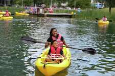 Erica LaCour and her four-year-old son, Darien, experience their first kayaking at Discovery Green Sunday, May 14, 2017, in Houston. The Sugar Land mother and son pair was at a family gathering to celebrate Mother's Day.