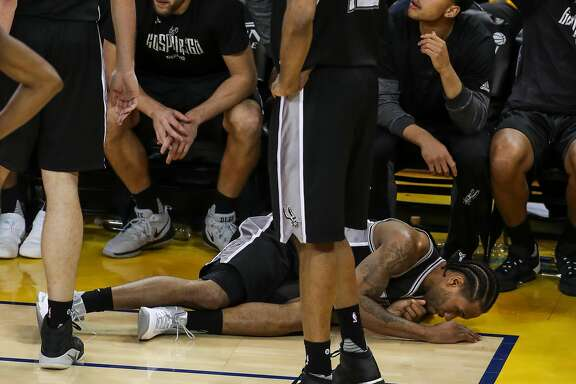 San Antonio Spurs' Kawhi Leonard hits the ground in the third quarter during Game 1 of the 2017 NBA Playoffs Western Conference Finals at Oracle Arena on Sunday, May 14, 2017 in Oakland, Calif.